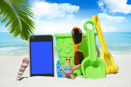 beach toys: Black Smartphone with empty screen display and Beach Toys on the Sand Beach