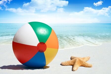 white sand beach: Fun day at the beach with goggles and beach ball