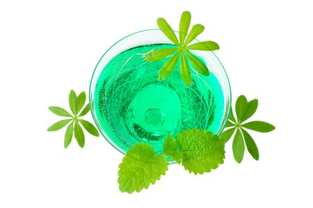 woodruff: Close up woodruff punch with woodruff and mint leaf isolated front of white background