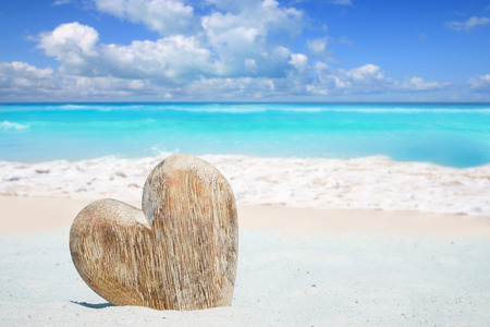 Large wooden heart with copy space on the sunny beach