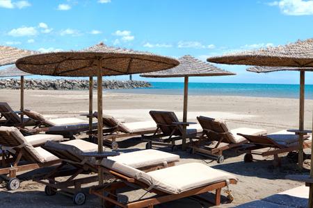 sunshades: Beach chairs and sunshades on Mediterranean beach