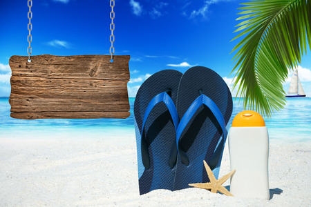 suntan lotion: Flip Flops, suntan lotion and wooden signboard with copy space on the beach Stock Photo