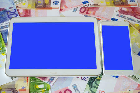 rate of return: White Tablet PC and a white smart phone with blue blank touchscreen on a background of Euro banknotes Stock Photo
