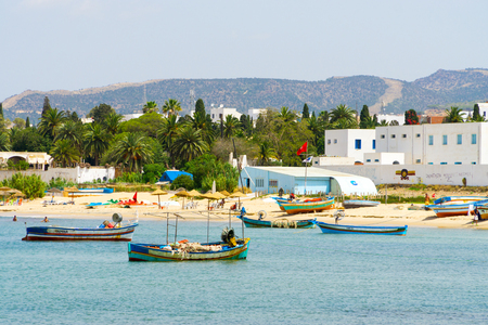 View of the beach and the sea at Hammamet with fishing boats in the water. Editorial