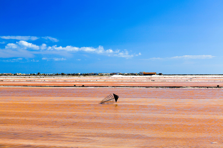 View of a large brine pool in the Saint-Martin saline with a metal sculpture in the water near the small French village of Gruissan in southern France