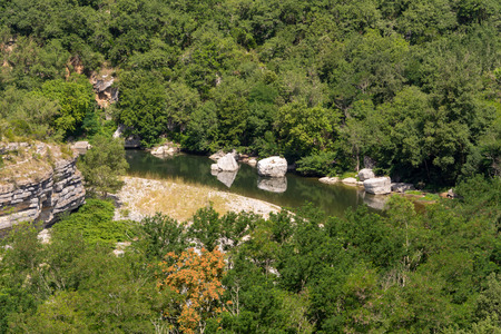 View of the river Ardeche, framed by rock faces and a lot of vegetation at