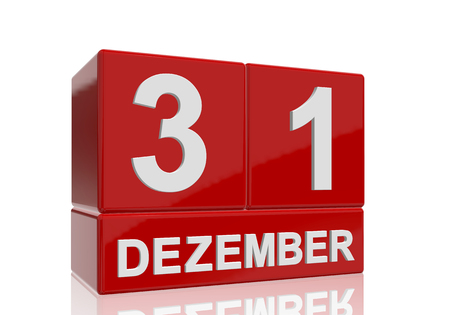 The date of 31 Dezember in white numbers and letters on red, glossy blocks, standing and mirrored isolated in front of a white background. 免版税图像