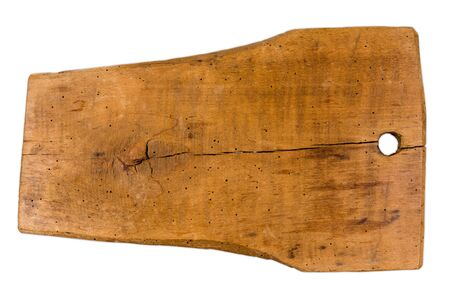 Old rustic hardwood chopping board in front of a white background