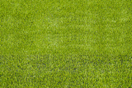 The detail of artificial green grass soccer field for backgroud