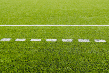 The white Line marking on the artificial green grass soccer field