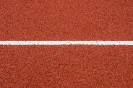 The running track rubber lanes cover texture with line for background. Stock Photo - 89706700