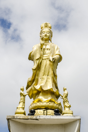 Guan Yin, Goddess of Mercy, Golden statue of bodhisattva in Trang,Thailand. Editorial