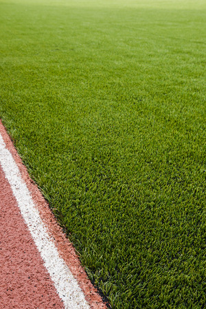 The running track rubber lanes in the artificial grass stadium.