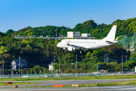 Jets take off and land at Fukuoka Airport 写真素材