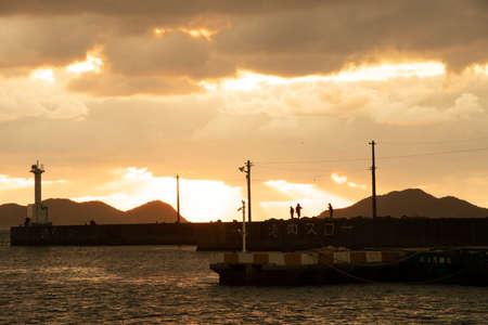 Angler at Bellzaki Port at sunset