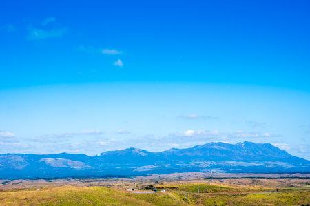 Kuju mountain range and grasslands seen from Daikanbo in autumn