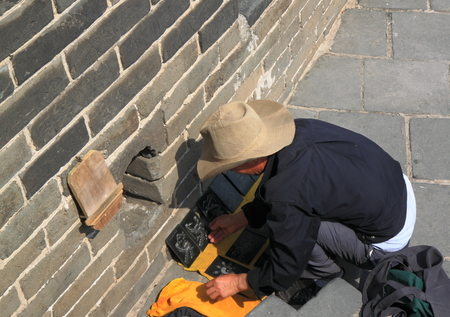 Beijing China - May 10,2012,Souvenir shop owner opening up his shop in the early morning at the Great Wall of China