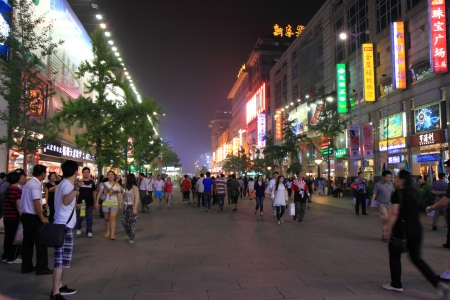 Beijing China - May 10,2012,Busy night scene of Wangfujing street, People enjoy shopping in Beijing China