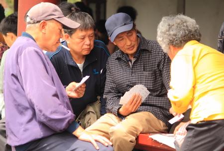 Beijing China - May 12,2012, People enjoying card games at Temple of Heaven Beijing China