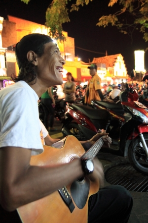 busker: Jogyakarta Indonesia - May 10,2013, local singer enjoying attention from people in Jogyakarta Indonesia
