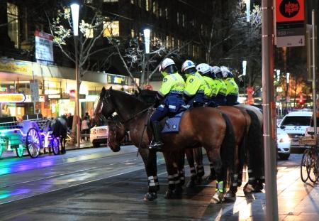 patrolling: Melbourne Australia- August 02,2013, Australian Police officers start patrolling by horse on Swanston Street Melbourne Australia on Friday night Editorial