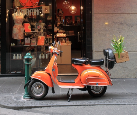 Melbourne Australia- August 03,2013, Orange Vespa parked on Degraves Street in Melbourne CBD Australia 報道画像