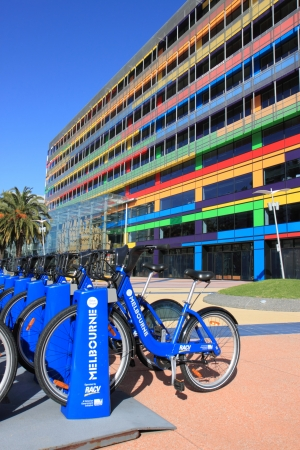 conducted: Melbourne Australia- August 10,2013, Bicycle hire scheme conducted by Victorian government,colourful office building in background Melbourne Australia