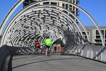 webb: Melbourne Australia- August 10,2013, Local cyclists riding on artistic design of Webb bridge in Docklands Melbourne Australia