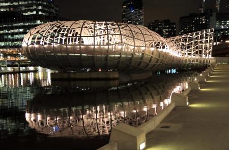 webb: Webb bridge light up and water reflection in Docklands Melbourne Australia