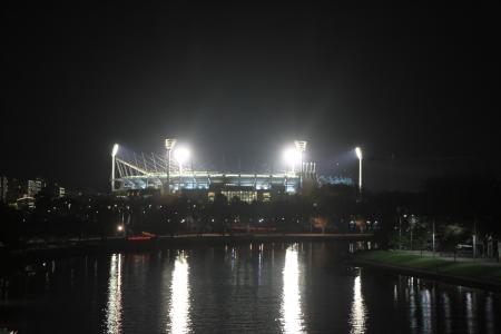 Stadium light reflecting Yarra river Melbourne Australia