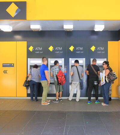 MELBOURNE AUSTRALIA - MARCH 29,2014  Unidentified people use Commonwealth Bank ATM