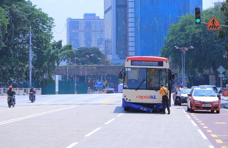 Kuala Lumpur Malaysia - 24 May, 2014  Local bus driver had traffic accident and calls for help in downtown Kuala Lumpur Malaysia