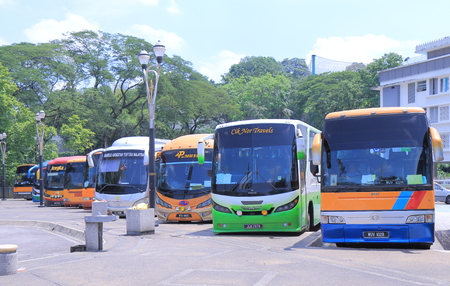 Kuala Lumpur Malaysia - 24 May, 2014  Local tour buses wait for passengers at National Mosque parking area in Kuala Lumpur Malaysia   報道画像
