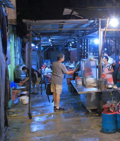 Kuala Lumpur Malaysia - 24 May, 2014   Local people buy a meal at a local restaurant in China town in Kuala Lumpur Malaysia
