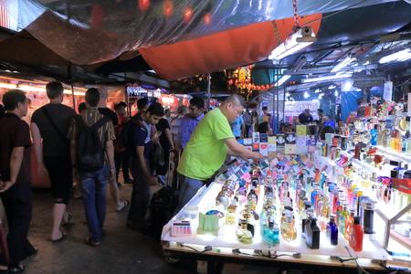 Kuala Lumpur Malaysia - 24 May, 2014  Local shop staff prepares perfume display in China town Kuala Lumpur Malaysia
