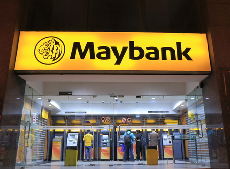 Kuala Lumpur Malaysia - 24 May, 2014  Local people use Maybank ATM in China town Kuala Lumpur Malaysia