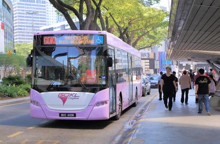 Kuala Lumpur Malaysia - 25 May, 2014 Free public transport GOKL bus runs near Petronas tower in Kuala Lumpur Malaysia   Editoriali