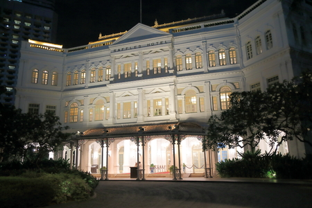 Singapore, Singapore - 26 May, 2014  Iconic beautiful Raffles Hotel light up in Singapore by night