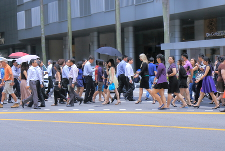 Singapore, Singapore - 27 May, 2014  Local business people cross road in downtown Singapore   Editoriali