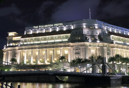 five star: Singapore, Singapore - 27 May, 2014  Five star hotel Fullerton Hotel light up by night in downtown Singapore   Editorial