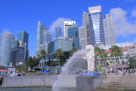 Singapore, Singapore - 28 May, 2014  Tourists sightsee Singapore Skyline and iconic Merlion in downtown Singapore