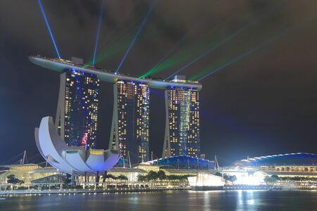Singapore, Singapore - 28 May, 2014  Beautiful Marina Bay Sands and ArtScience Museum light show in Marina Bay Singapore