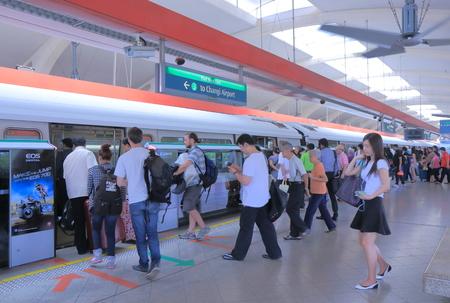 merah: Singapore, Singapore - 29 May, 2014  Tourists and local people take MRT at Tanah Merah Station in Singapore   Editorial