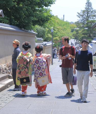 Kyoto Japan - 1 June, 2014  Geisha girls walk on street in Higashiyama district Kyoto Japan