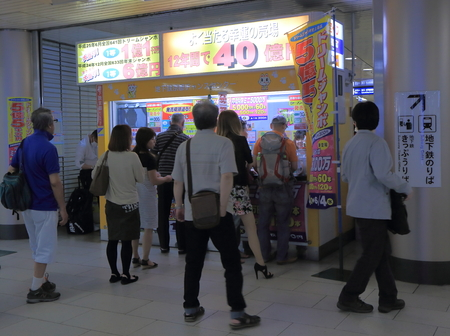 Kyoto Japan - 1 June, 2014  Local people queue to buy lottery tickets at Kyoto station  in Kyoto Japan