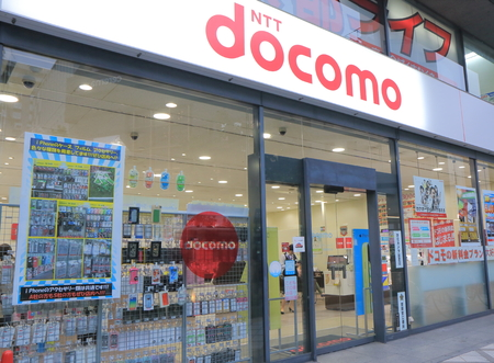 Kyoto Japan - 3 June, 2014  Shop staff work at NTT Docomo mobile phone shop in Kyoto Japan