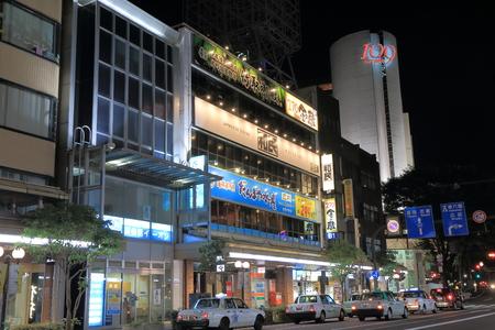 Kanazawa Japan - 16 June, 2014  Taxis wait for passengers in busy Korinbo shopping district by night in Kanazawa Japan