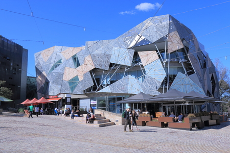 federation: Melbourne Australia - August 23, 2014: People sightsee Federation Square