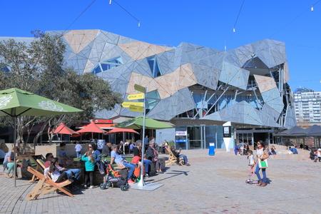 sightsee: Melbourne Australia - August 23, 2014: People sightsee Federation Square
