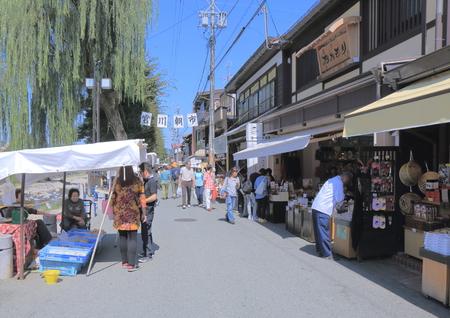 Takayama Japan - September 23, 2014: People sightsee Miyagawa Morning Market in Takayama Japan